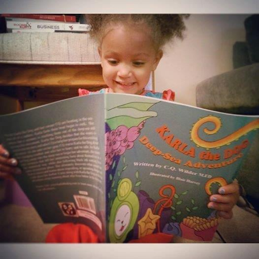 Laila looks so focused reading her book!