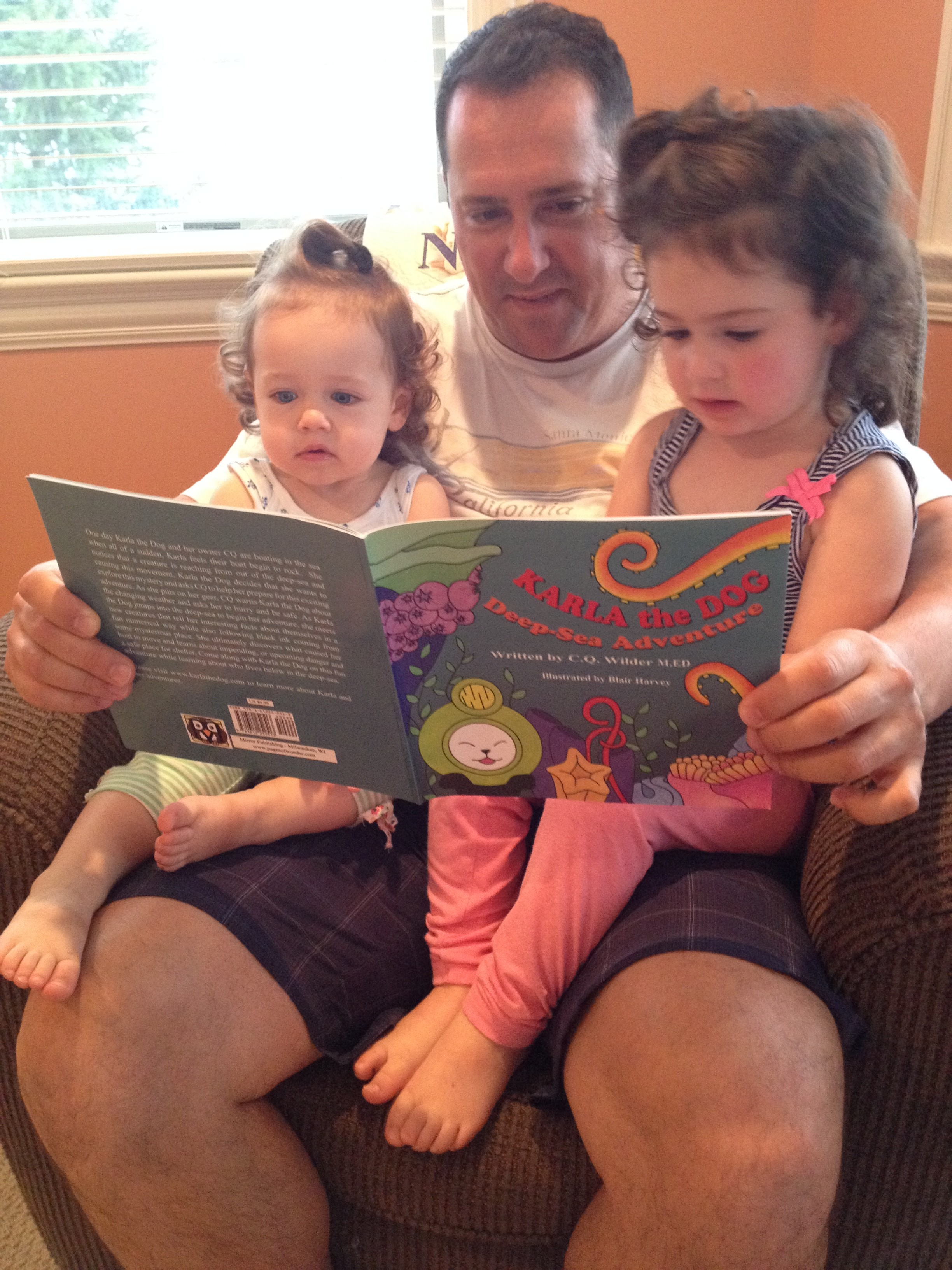 Savannah and Brooklynn and reading their Karla book with their father!