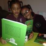 Athena and Ariana love reading Karla! It's all family love.